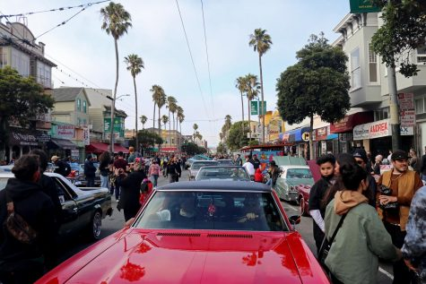 Crowds and lowriders gather in Mission Street to celebrate San Francisco Lowrider Council 40th anniversary on Sept. 18, 2021. (Sabita Shrestha/Golden Gate Xpress)