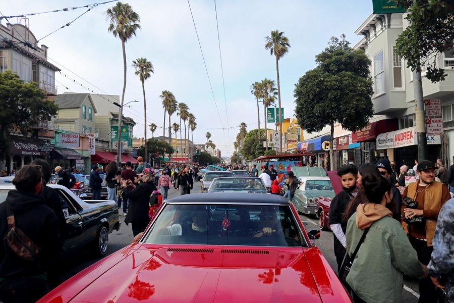 Crowds and lowriders gather in Mission Street to celebrate San Francisco Lowrider Council 40th anniversary on Sept. 18, 2021.