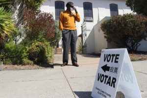 James Mcoy, a poll worker, stands outside a poll center to guide voters inside in El Cerrito on Sept. 14, 2021. (Sabita Shrestha / Golden Gate Xpress)