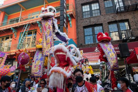 """Providing the festival's final performance, Leung's White Crane Dragon and Lion Dance Association prepare to start a parade down Grant Ave. to celebrate the 31stannual Autumn Moon Festival in Chinatown on Sept. 12, 2021. """"For the past 31 years, we've been trying very hard to bring business back into Chinatown,"""" entertainment coordinator Cynthia Yeesaid in regard to the curation of the Autumn Moon Festival. (Morgan Ellis/Golden Gate Xpress)"""