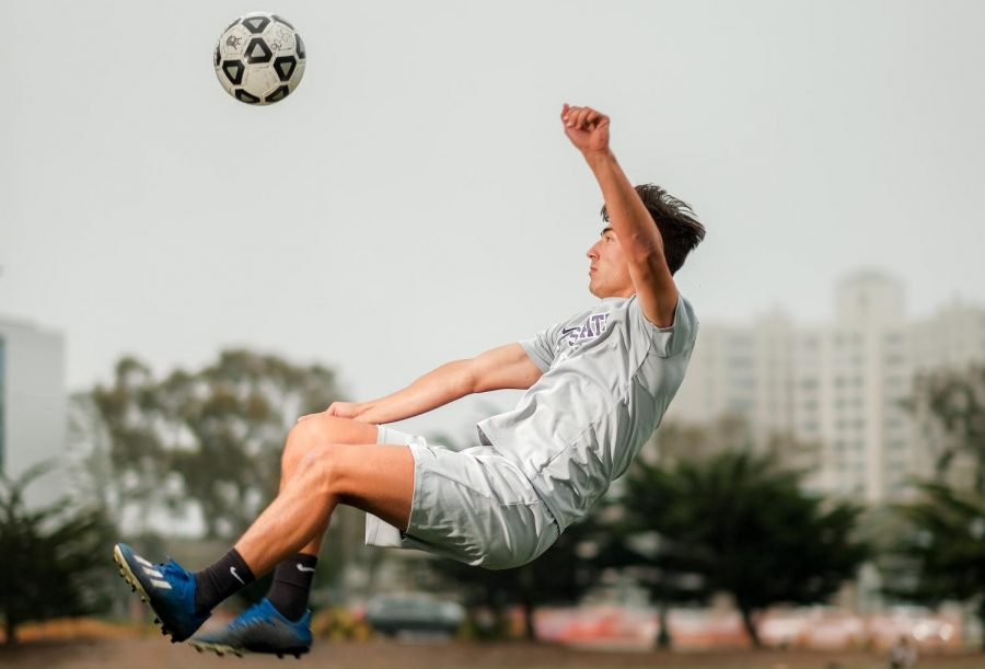 Gustavo Ferrari kicks a soccer ball midair on Sept. 24, 2021. Ranking third in NCAA, Gustavo was named the CCAA player of the week. (Cameron Lee / Golden Gate Xpress)