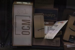 An OCM package sits on a rack at an office at SF State on Sep 22, 2021. (Nicholas Cholula / Golden Gate Xpress)