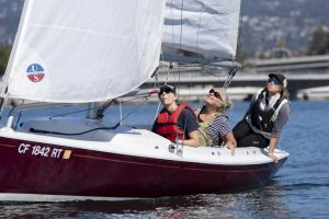 (Right to Left) Rebecca Hinden, Lisa Rohr and Kathy Logan sail a Harbor 20 sailboat named Puff Mommy during a regatta at the Oakland Estuary in Alameda, Calif., on Oct. 10, 2021. Rohr offered up her boat to be used during the 29th Women's Sailing Seminar. (Nicolas Cholula/Golden Gate Xpress)