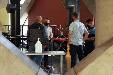 UCorp Staff and owners of vendors discuss indoor seating on the Lower Plaza level on Sept. 29, 2021. Reopening of indoor seating will happen next Monday.(Amaya Edwards / Golden Gate Xpress)