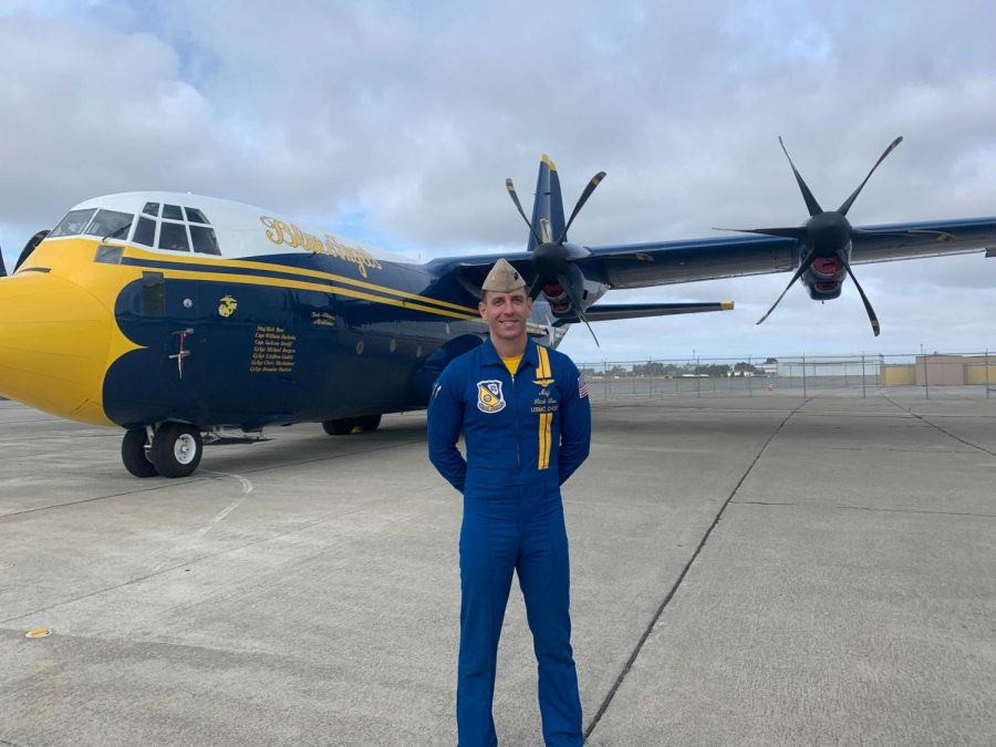 Behind Maj. Rick Rose stands Fat Albert, a C-130J Hercules aircraft, on Oct. 7, 2021, at Oakland International Airport. After the pandemic resulted in fleet week being cancelled in 2020, a large mass convened Oct. 8 to 10 to the Marina Green to witness the air acrobatics. (Matthew Cardoza / Golden Gate Xpress)